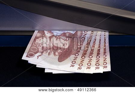 Paper cutters and banknote.