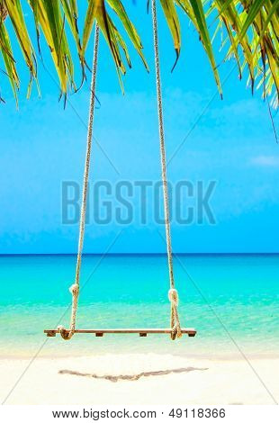 Swing on exotic sunny beach