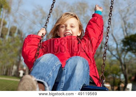 happy girl on a swing