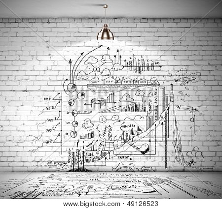 Drawn business plan on wall illuminated by lamp above poster