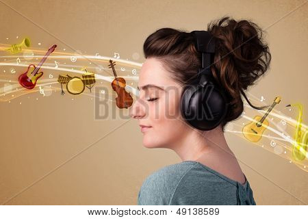 Pretty young woman listening to music, instruments concept