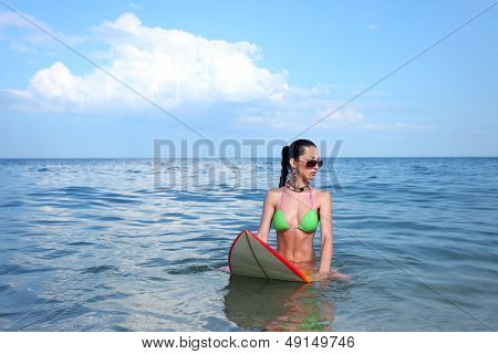Brunette Girl with a Surf