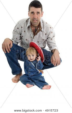 Portrait Of Father And Baby Cowboy Theme