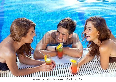Guy Flirting With Two Women At The Swimming Pool