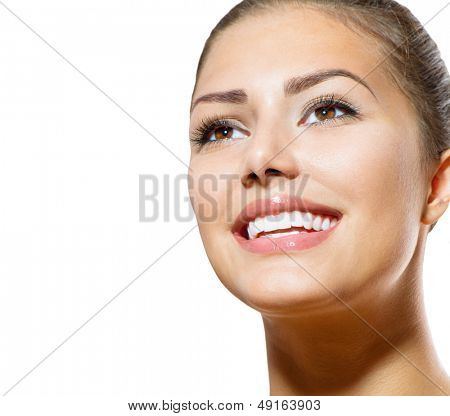 Healthy Smile. Teeth Whitening. Beautiful Smiling Young Woman Portrait. Over White background . Laughing Girl poster
