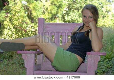 Teen Girl Sprawling In A Chair