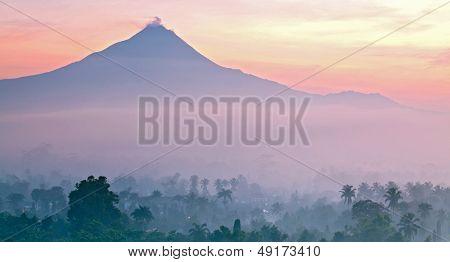 Sunrise Mountain Landscape of Mount Merapi Volcano from Borobudur Yogyakarta Indonesia