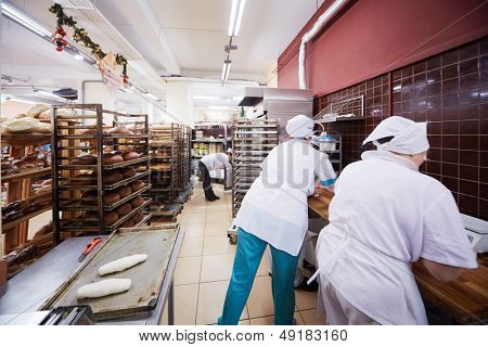 MOSCOW - DEC 8: Women work in bakery of supermarket of home food Bahetle, December 8, 2012, Moscow, Russia. Currently company Bahetle has 25 stores.