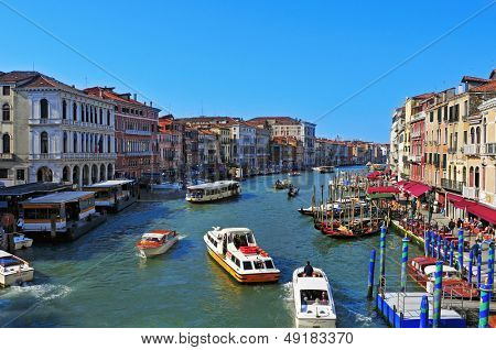 VENICE, ITALY - APRIL 13: A view of the Grand Canal from Rialto Bridge on April 13, 2013 in Venice, Italy. This main canal is 3800 meter long, 30-90 meters wide, with an average depth of 5 meters