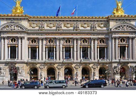 PARIS, FRANCE- MAY 18: Main facade of the Opera Garnier or Palais Garnier on May 18, 2013 in Paris, France. This famous opera house, inaugurated in 1875, has 1,979 seats