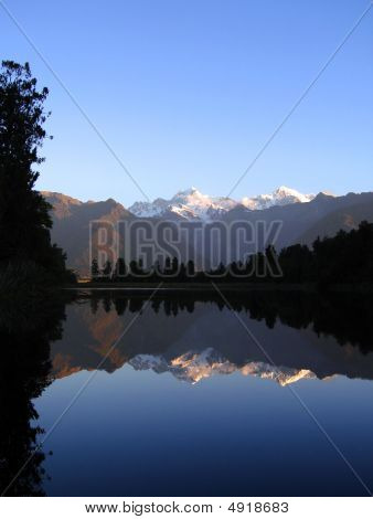 Mount Cook And Mount Tasman Reflected In Lake Matheson, New Zealand