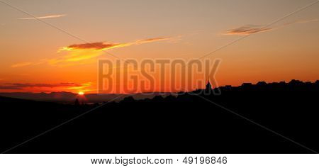Sunrise silhouette of a wine village in the french Alsace region near Riquewihr