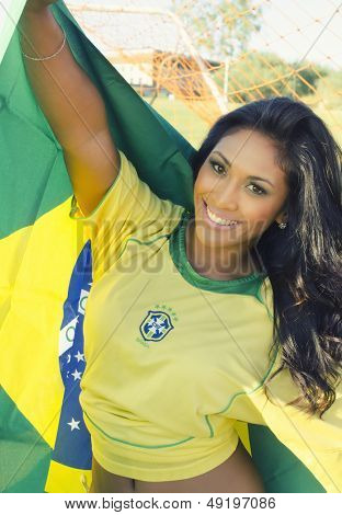 Happy smiling Brazil soccer football fan.... ( Brazil World Cup Finals 2014 )
