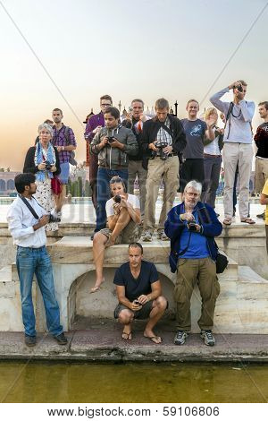People Take Pictures At Taj Mahal In India