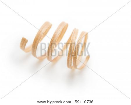 Spring like wood shavings isolated on white. Shallow depth of field.