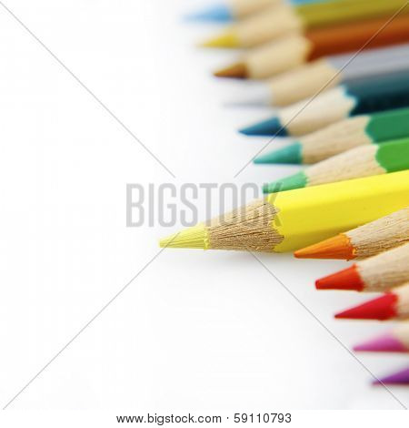 Yellow pencil standing out from others
