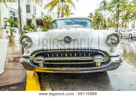Classic Oldsmobile With Chrome Radiator Grill Parked In Front Of The Restaurant In Hotel Avalon