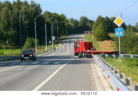 Red Tow Truck. Road Signs
