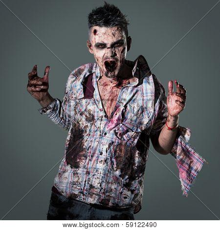 Aggressive, creepy zombie in clothes
