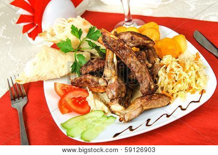 Meat On Stones With Vegetables