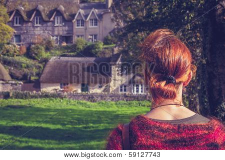 Woman Looking At Fairytale Houses