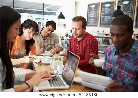 Customers In Busy Coffee Shop