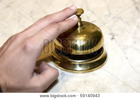 Hand Playing A Hotel Bell