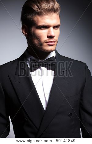 face of a handsome caucasian man in tuxedo posing in studio