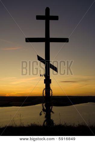 Orthodox cross on an evening sunset sky