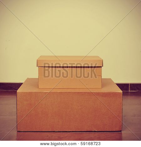 picture of some cardboard boxes on the floor with a retro effect