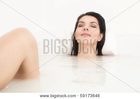Blissful Woman Soaking In A Hot Bath