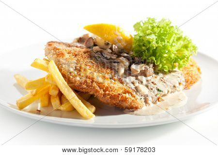 Vienna Schnitzel Served with Mushroom Sauce and French Fries