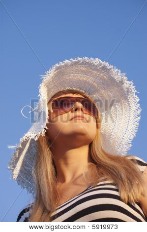 Young Smiling Blond Woman With White Hat