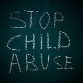 sentence stop child abuse written in a chalkboard poster