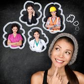 Career choice options - student thinking of future education. Young Asian woman contemplating career options smiling looking up at thought bubbles on a blackboard with images of different professions poster