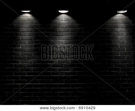 Spotlights On A Black Brick Wall
