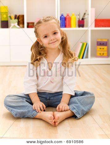 Happy Healthy Little Girl Sitting On The Floor