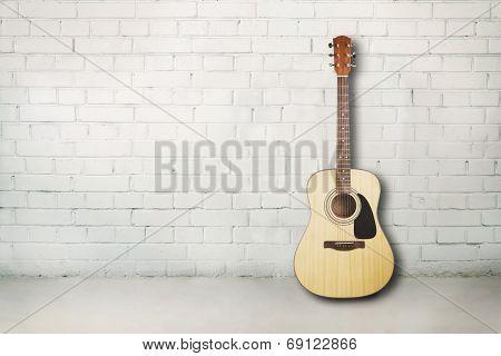 Acoustic guitar in room