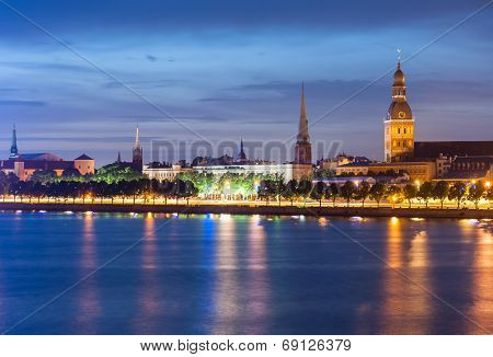Skyline of Riga seen across the river Daugava after the sunset. The tallest building on the picture is the Riga Dome cathedral, smaller one to the left is St. Saviour's Church