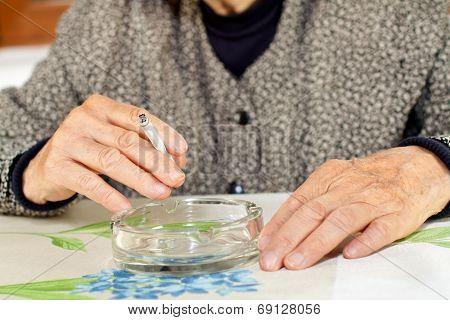 Elderly woman addicted to nicotine and smoking poster