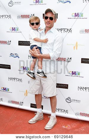 BRIDGEHAMPTON, NY-JUL 19: Actor Dan Abrams (R) and son Everett attend the 6th Annual Family Fair at the Children's Museum of the East End (CMEE) on July 19, 2014 in Bridgehampton, New York.
