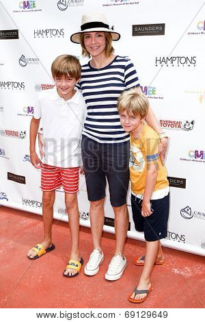 BRIDGEHAMPTON, NY-JUL 19: (L-R) William Lawrence, Christa Miller & Henry Lawrence attend the Annual Family Fair at Children's Museum of the East End (CMEE) on July 19, 2014 in Bridgehampton, New York.