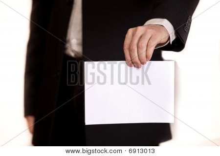 The document in a hand of the businessman