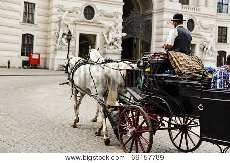 Horse drawn carriage in Vienna transporting tourists poster