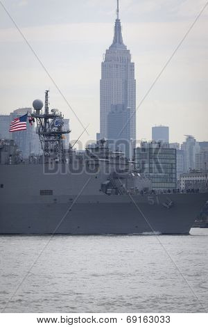 NEW YORK - MAY 27: USS Oak Hill (LSD 051) passes the Empire State Building after departing Pier 92 on the Hudson River at the end of Fleet Week NY on May 27, 2014.