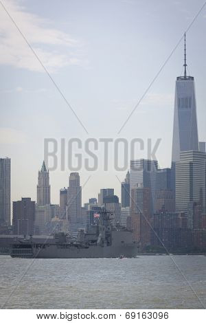 NEW YORK - MAY 27: USS Oak Hill (LSD 051) passes the Freedom Tower in the financial district of Lower Manhattan after departing Pier 92 on the Hudson River at the end of Fleet Week NY.