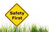 yellow sign with safety first as aid concept poster