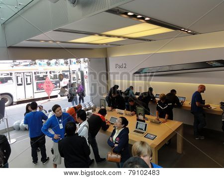 People Look At Products And Talk To Sales Reps Inside Apple Store