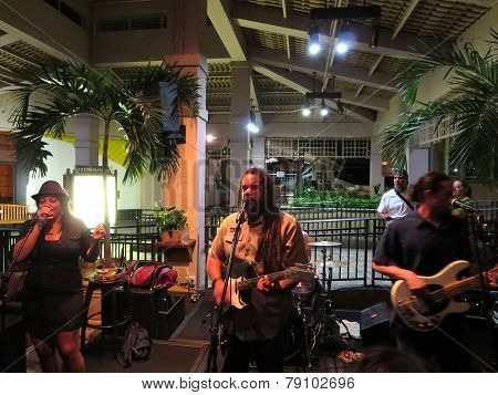 Guidance Band Sings And Jams On Guitar And Drums On Stage At Mai Tai Bar