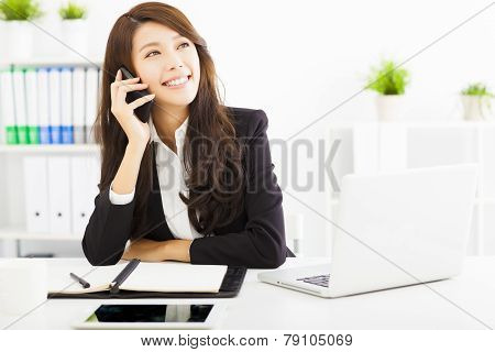 Happy Business Woman Talking On The Phone In Office